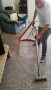 professional carpet cleaning using vacuum